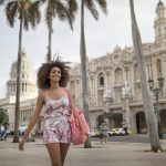 Happy beautiful woman walking in city