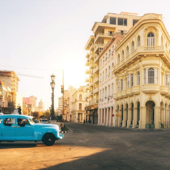 Vintage American car speeding along road in Havana, Cuba